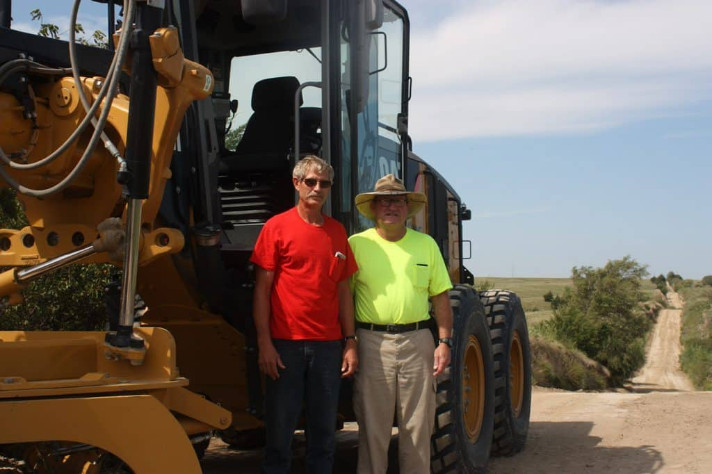 Mike Snyder and man in front of a Cat truck