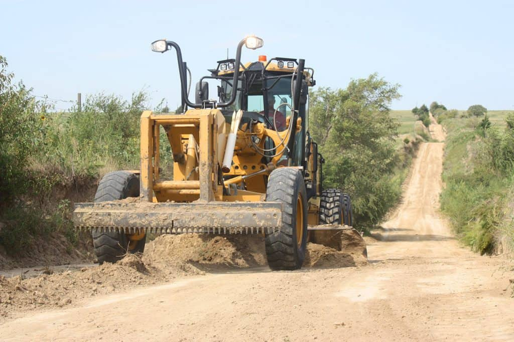 close up of Cat truck on a long dirt road