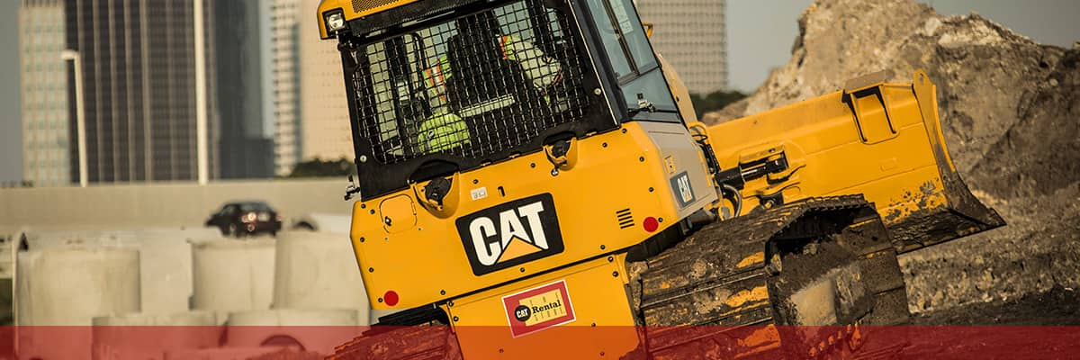 Man operating Cat equipment