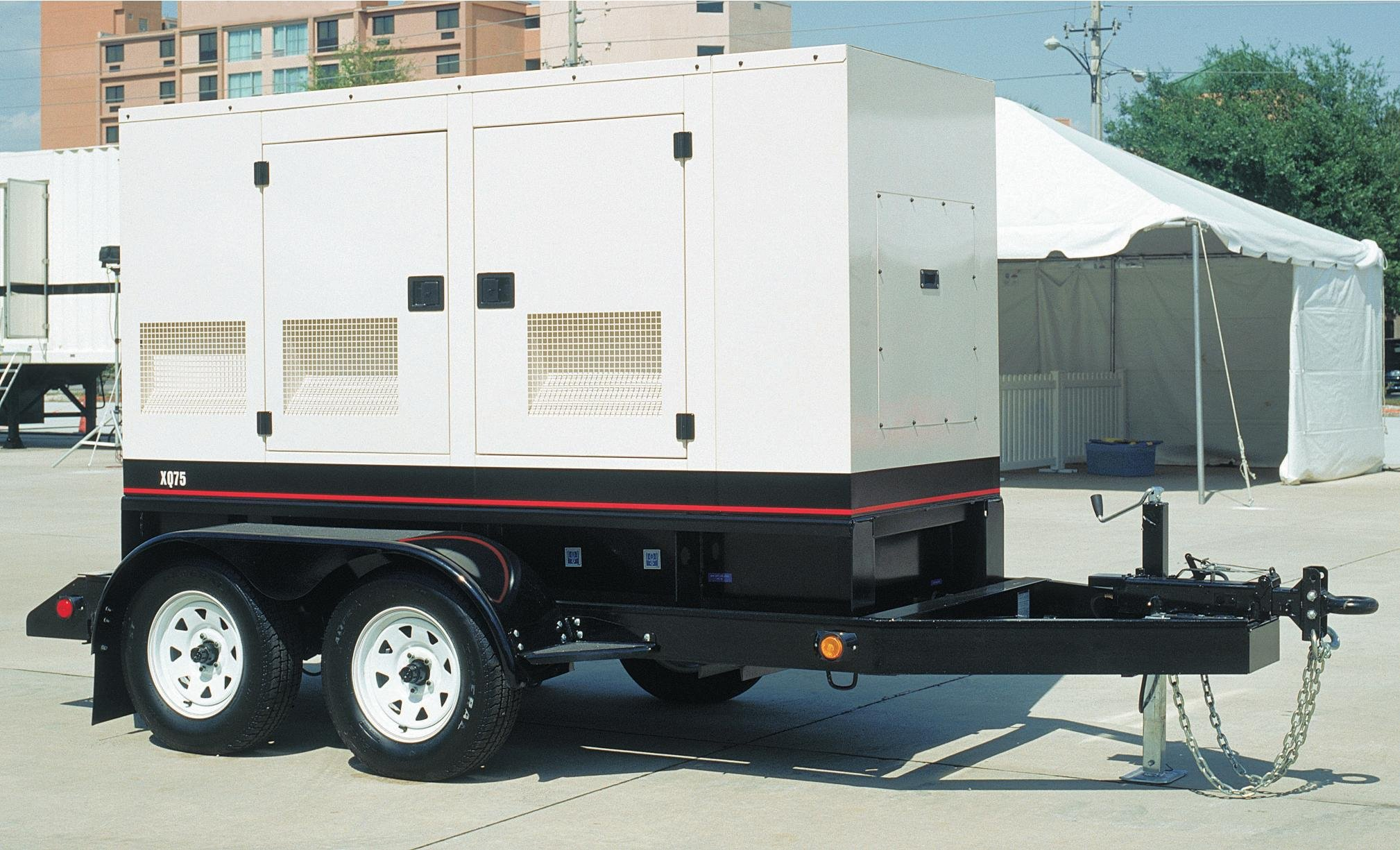 white mobile power generator on a site
